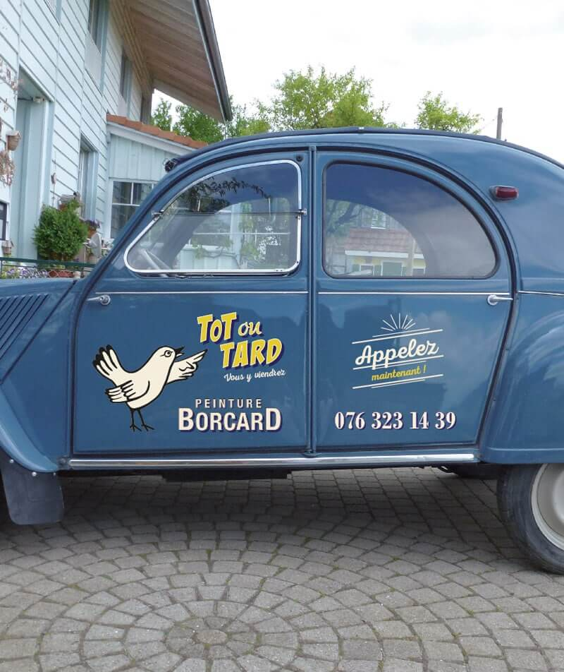 Sign painting 2CV pub vintage peint à la main christian borcard avec logo d'un oiseau